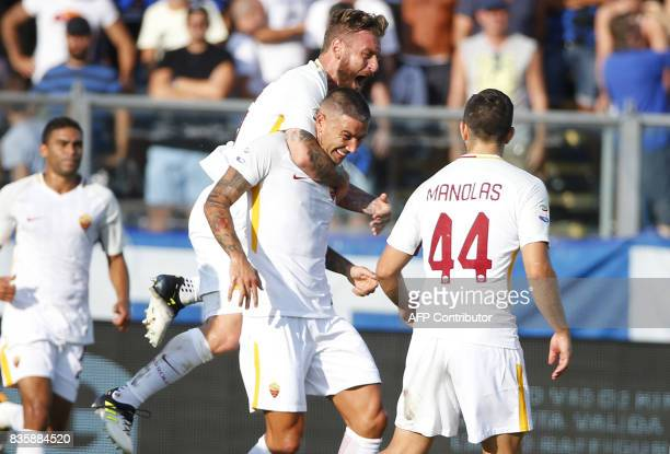 AS Roma's Serbian defender Aleksandar Kolarov celebrates with AS Roma's midfielder Daniele De Rossi after scoring a goal during the Italian Serie A...