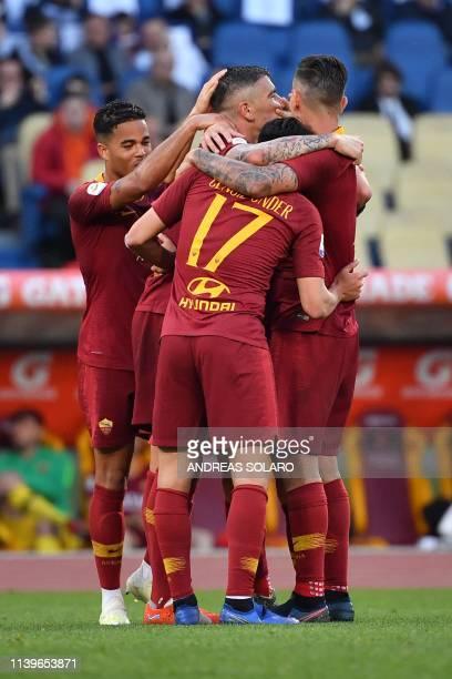 Roma's Serbian defender Aleksandar Kolarov celebrates with teammates after scoring a goal during the Italian Serie A football match between AS Roma...