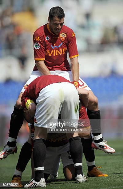 AS Roma's Simone Perotta jumps over Brazilian Amantino Mancini who jubilates as he scores the third goal during AS Roma vs Torino Italian Serie A...