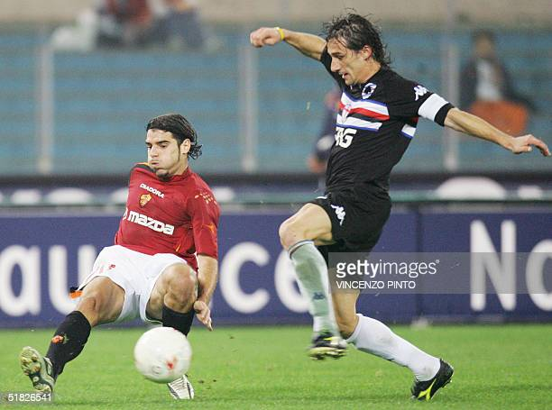 Roma's Simone Perrotta tries to tackle Sergio Volpi of Sampdoria during their Italian Serie A football match at Olympic stadium in Rome 05 December...