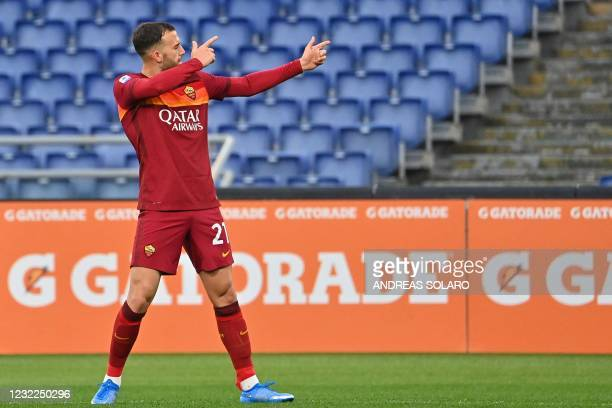 Roma's Spanish forward Borja Mayoral celebrates after opening the scoring during the Italian Serie A football match AS Rome vs Bologna on April 11,...