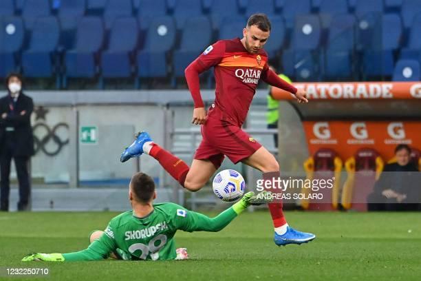 Roma's Spanish forward Borja Mayoral dribbles Bologna's Polish goalkeeper Lukasz Skorupski to open the scoring during the Italian Serie A football...