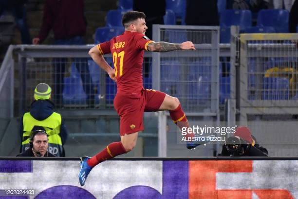 Roma's Spanish forward Carles Perez celebrates after scoring a goal during the UEFA Europa League round of 32 first leg football match AS Roma vs KAA...