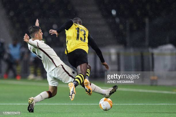 Roma's Spanish midfielder Gonzalo Villar tackles Young Boys' Cameroon midfielder Moumi Ngamaleu as they fight for the ball with during the UEFA...