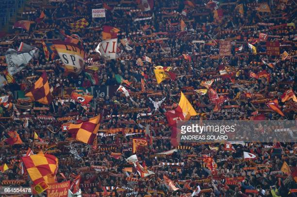 AS Roma's supporters cheer during the Italian Tim Cup second leg semifinal football match AS Roma vs Lazio on April 4 2017 at the Olympic stadium in...