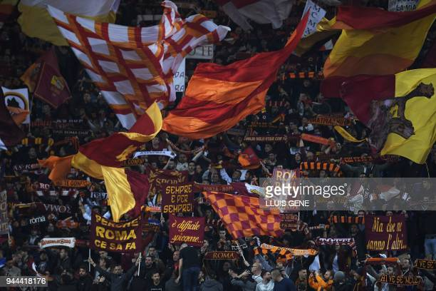 AS Roma's supporters cheer during the UEFA Champions League quarterfinal second leg football match between AS Roma and FC Barcelona at the Olympic...