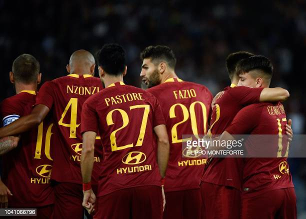 Roma's Turkish forward Cengiz Under celebrates with teammates after scoring a goal during the Serie A football match between AS Roma and Frosinone on...
