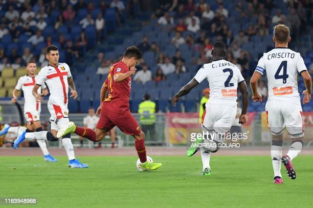 AS Roma's Turkish forward Cengiz Under shoots to open the scoring during the Italian Serie A football match Roma vs Genoa on August 25 2019 at the...
