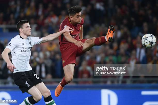 Roma's Turkish midfielder Cengiz Under challenges Liverpool's Scottish defender Andrew Robertson during the UEFA Champions League semifinal second...