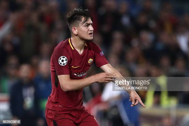 Roma's Turkish midfielder Cengiz Under gestures to the referee after Liverpool's Estonian defender Ragnar Klavan handled the ball in the penalty area...
