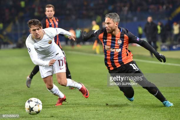 Roma's Turkish midfielder Cengiz Under vies for the ball with Shakhtar Donetsk's midfielder Marlos during the UEFA Champions League round of 16 first...