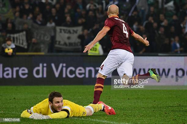 AS Roma's US midfielder Michael Bradley celebrates after scoring during the Serie A football match Udinese vs AS Roma at Stadio Friuli in Udine on...