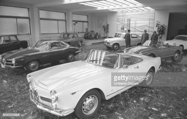 Rome Alfa Romeo showroom with a Giulietta Sprint Speciale two Giulia Spider a Dauphine a Giulietta TI