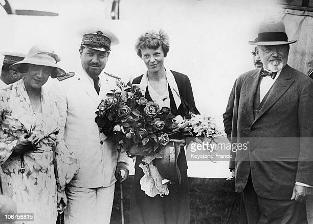 Rome American Aviatrix Amelia Earhart With The Italian Air Minister Italo Balbo And Mr Garret Ambassador Of The United States At Her Arrival In 1932