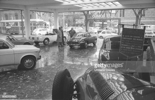 Rome an Alfa Romeo cars showroom with a red Giulietta Sprint Speciale and a white Giulia Spider
