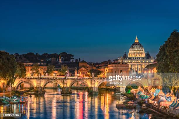 rome city at night with tiber river and st. peter's basilica, italy - lazio foto e immagini stock
