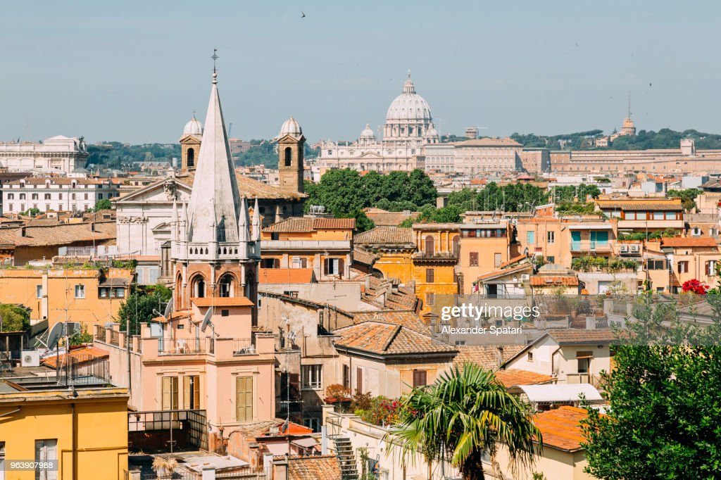 Rome cityscape on a sunny day with dome St Peter's Basilica in the background, Italy : Stock Photo