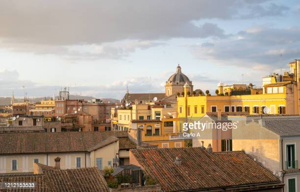 rome cityscape with rooftops at sunset - rome italy stock pictures, royalty-free photos & images