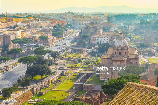rome cityscape with the colosseum in the background - roma stock photos and pictures