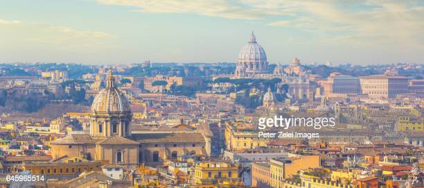 Rome cityscape with the dome of St. Peter's Basilica in the distance