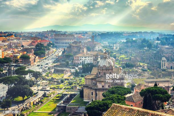 rome cityscape with the roman forum and the colosseum in the background - rome italy stock pictures, royalty-free photos & images