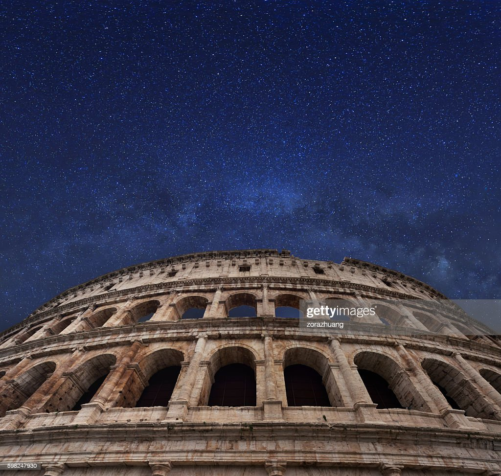 Rome coliseum and milky way in the midnight sky : Stock Photo