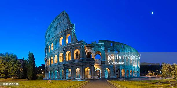 rome coliseum by moonlight ancient roman amphitheater night panorama italy - coliseum rome stock photos and pictures