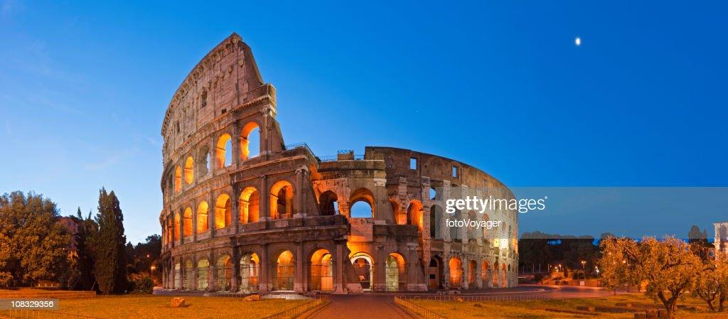 Rome Coliseum Colosseo ancient roman amphitheatre Italy panorama blue moon : Stock Photo