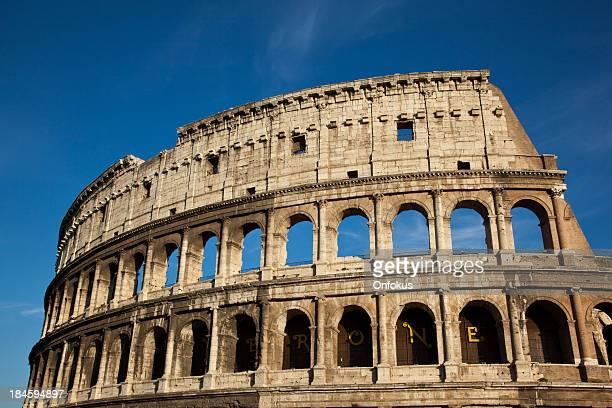 Rome Coliseum on blue sky, Italy
