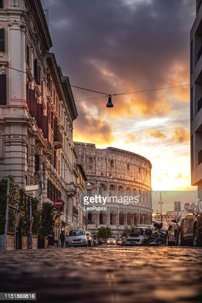 rome colosseum in a beautiful light at sunset - roma stock photos and pictures