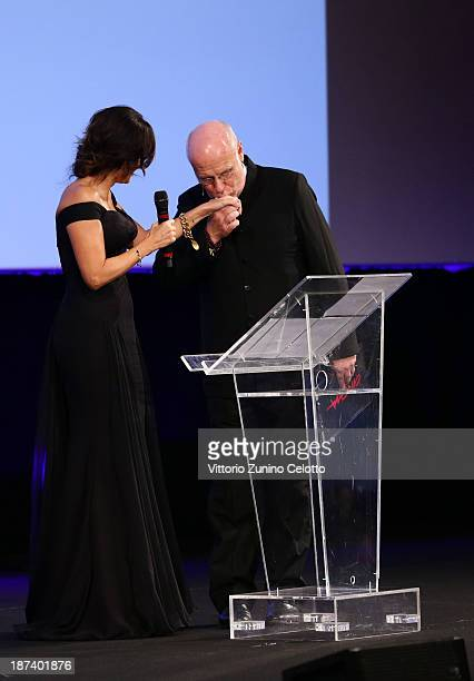 Rome Film Festival director Marco Mueller kisses the hand of Sabrina Ferilli at the Opening Ceremony Inside during The 8th Rome Film Festival on...