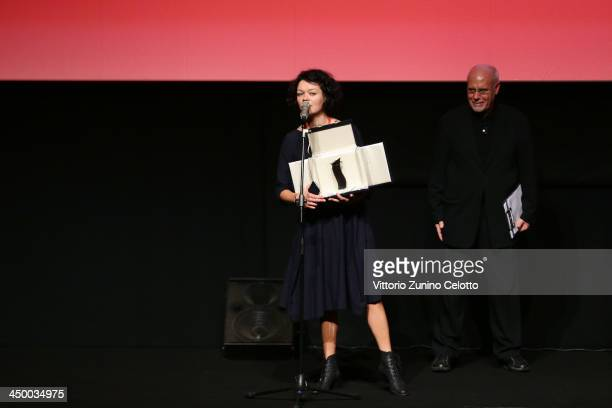 Rome Film Festival director Marco Mueller stands with Lenka Kabankova poses with her Best Cinematography Studio Universal Award for Na Pravakh...