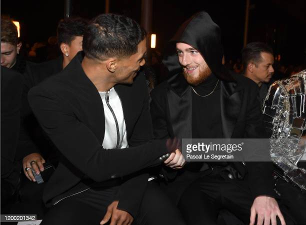 Rome Flynn and Angus Cloud attend the Balmain Menswear Fall/Winter 20202021 show as part of Paris Fashion Week on January 17 2020 in Paris France