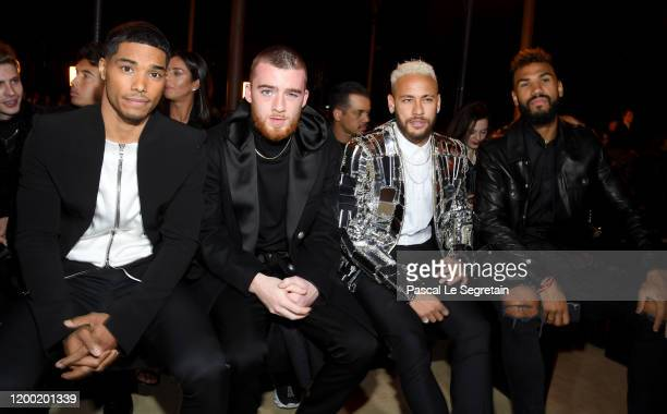 Rome Flynn Angus Cloud Neymar and Eric ChoupoMoting attends the Balmain Menswear Fall/Winter 20202021 show as part of Paris Fashion Week on January...