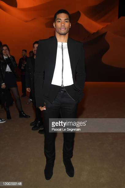 Rome Flynn attends the Balmain Menswear Fall/Winter 20202021 show as part of Paris Fashion Week on January 17 2020 in Paris France