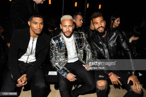 Rome Flynn Neymar and Eric Maxim ChoupoMoting attend the Balmain Menswear Fall/Winter 20202021 show as part of Paris Fashion Week on January 17 2020...