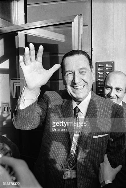 Former Argentine dictator Juan D Peron greets newsmen with a wave and broad smile as he arrives at his hotel following flight from Madrid Nov 14 He...