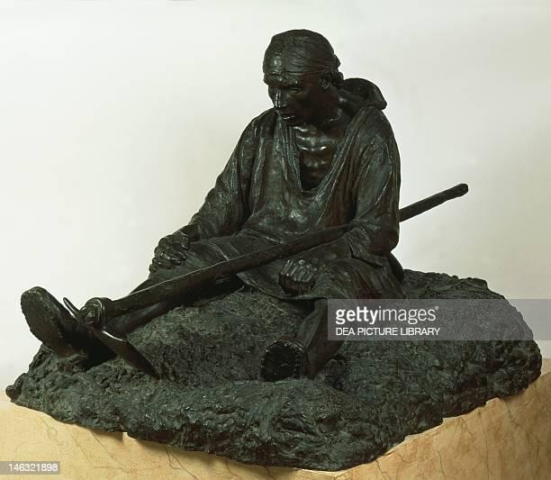 Rome, Galleria Nazionale D'Arte Moderna Proximus tuus by Achille d'Orsi , bronze.