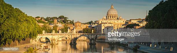 Rome golden dawn over River Tiber Vatican City panorama Italy