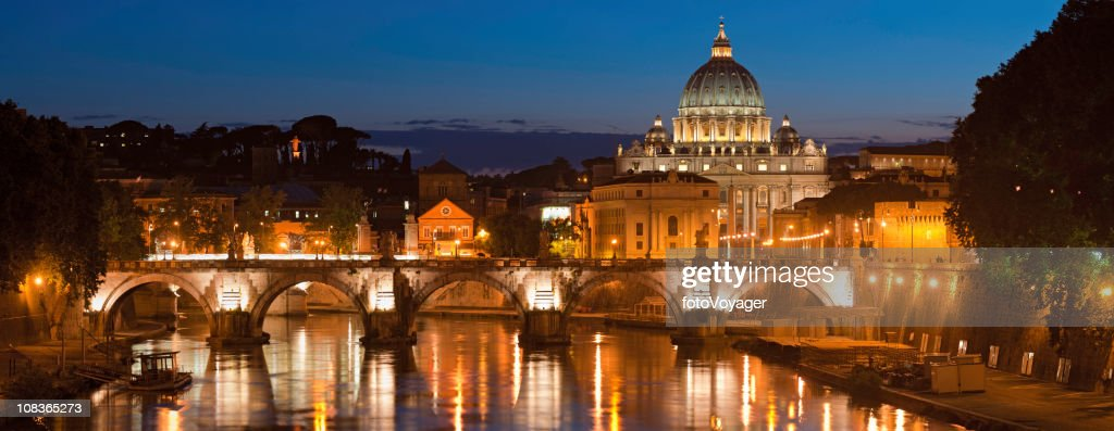 Rome illuminated dusk over River Tiber St Peters Vatican Italy : Stock Photo