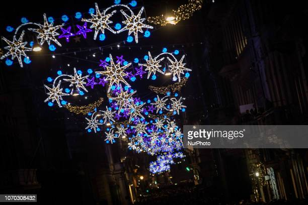 Rome Italy 08 December People take pictures of Christmas lights adorning Via del Corso on Rome Italy 08 December 2018