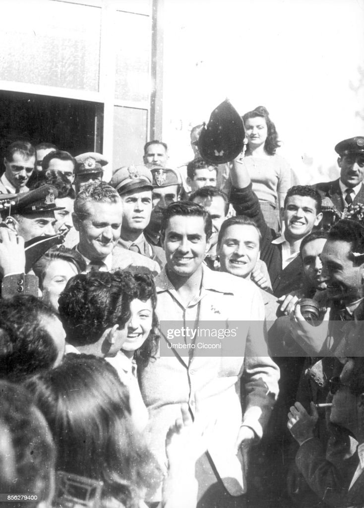 Rome, Italy, , Tyrone Power, surrounded by fans, visits the church of Santa Francesca Romana in Rome. Two years later he married Linda Christian at the same church.