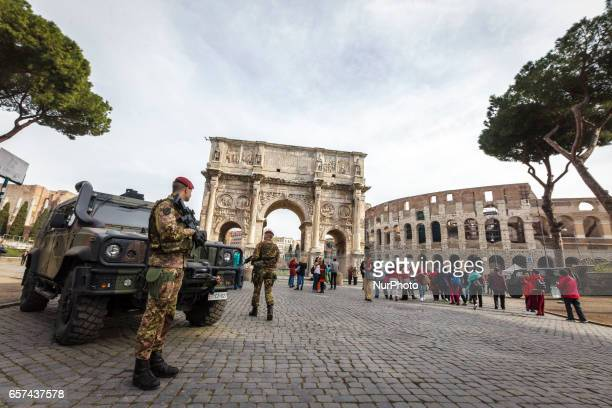 Rome Italy 24th March 2017 Italian military corps stands in front of the Arch of Constantine near the Colosseum a day ahead of an European Union...