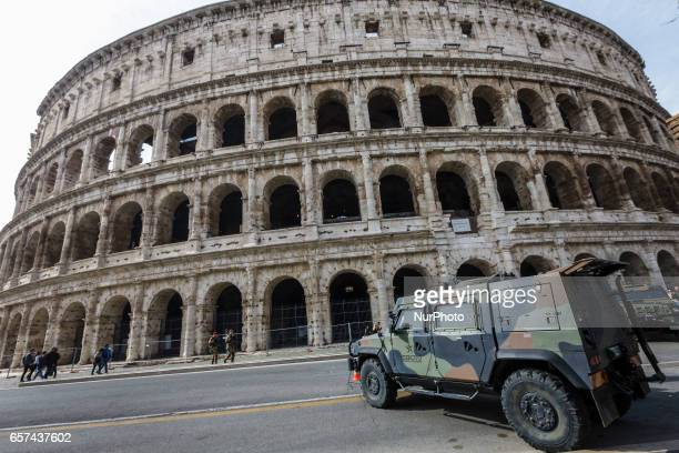 Rome Italy 24th March 2017 Italian military corps stands in front of the Colosseum a day ahead of an European Union summit commemorating the 60th...