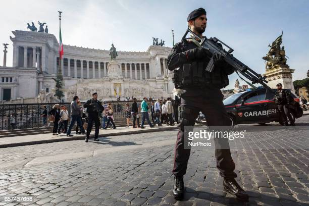 Rome Italy 24th March 2017 Italian paramilitary police patrol stands in front of the Monument of the Unknown Soldier in Piazza Venezia Square a day...