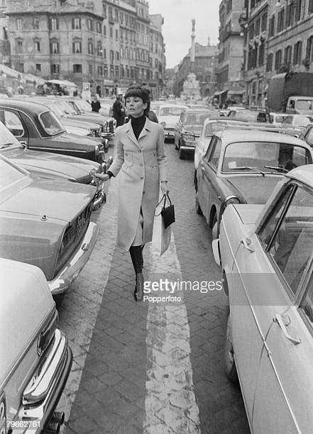 Rome Italy 26th March 1971 American film actress Audrey Hepburn strolls between parked cars in the Piazza di Spagna