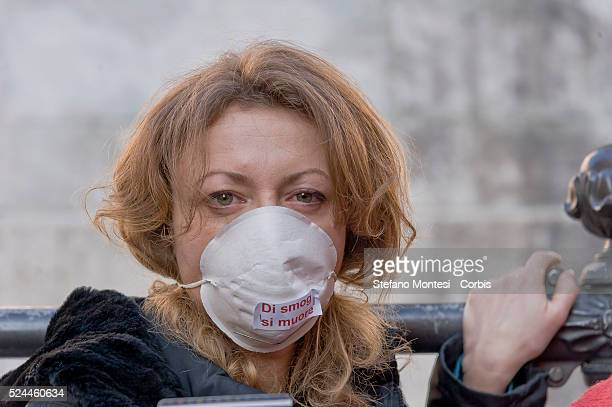 Rome Italy 29rd December 2015 The Greens protest in Piazza Montecitorio against smog and pollution masks on the face jars filled with exhaust fumes...