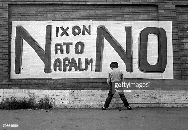 Rome Italy 29th September 1970 A young local boy urinates onto a brick wall covered with graffiti in protest against American President Richard Nixon...