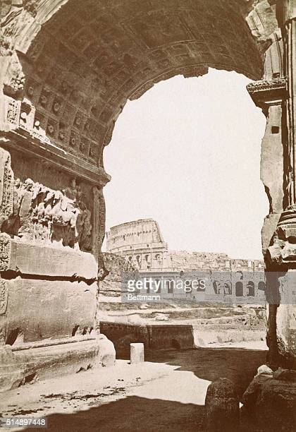 A glimpse of the Colosseum through the arch of Titus Undated photograph