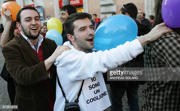 A supporter of opposition leftwing parties demonstrates in Rome 04 April 2006 after Italy's conservative Prime Minister Silvio Berlusconi used a...